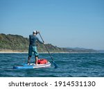 Active Man Paddling On Stand Up ...