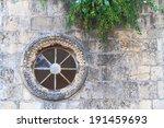 Round Window On An Old Stone...
