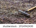 Garden rake. black metal rake...