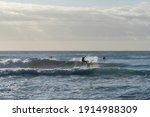 Surfer Doing A Big Turn Carve...