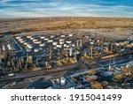 Aerial View of Wind Turbines lurking behind an Oil Refinery in Casper, Wyoming