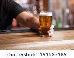 freshly tapped beer. bartender... | Shutterstock . vector #191537189