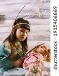 Little Indian Girl Holding A...