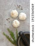 Three Heads Of Garlic With A...