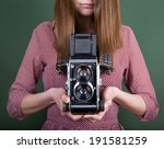 Vintage Camera In Hand On Green