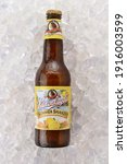 Small photo of IRVINE, CA - JUNE 2, 2015: Bottle of Leinenkugel Summer Shandy on a bed of ice. Leinenkugel was founded in Chippewa Falls, WI, in 1867 by Jacob Leinenkugel.