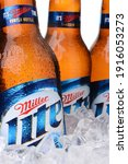 Small photo of IRVINE, CA - MAY 30, 2014: Closeup of Miller Light beer bottles in ice. Introduced in 1975 Miller Lite was one of the first Reduced Calorie beers to be successful in the American marketplace.