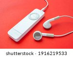 Small photo of Calgary, Alberta, Canada. Feb 13, 2021. First-generation iPod Shuffle. A digital audio player designed and formerly marketed by Apple. The smallest model in Apple's iPod family.