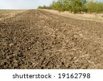 edge of the fallow field of black earth - stock photo