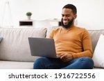 Black Man Using Laptop Computer ...