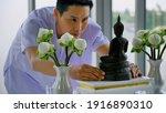 A Buddhist Man Taking A Buddha...