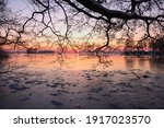 Frozen Lake With Silhouette Of...