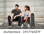 Young asian adult man and woman ...