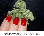 Closeup of fingers with red nails and crumbled eyeshadow. Manicure and makeup concept - stock photo