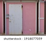A White Wooden Door Of A Pink...