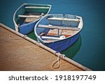 Two Old Rowboats Docked In...