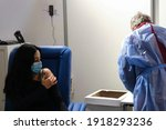 Small photo of A medical staff inoculates a woman with the AstraZeneca COVID-19 vaccine at Belgium's largest vaccination center in Brussels Expo exhibition halls in Brussels, Belgium on February 16th, 2021.