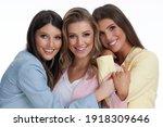 Three Women In Pastel Suits...