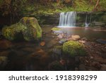 A Small Woodland Waterfall In...