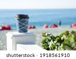 A Blue Paper Cup With Coffee...