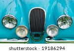 front of blue classic car...