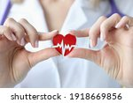 Small photo of Doctor holds in his hands an icon with cardiogram of heart. Heart and vascular disease concept