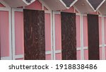 A Set Of Pink Beach Huts With A ...