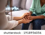 Small photo of African psychologist hold hands of girl patient, close up. Teenage overcome break up, unrequited love. Abortion decision. Psychological therapy, survive personal crisis, individual counselling concept