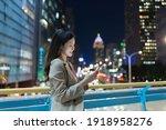 Asian Woman Use Smartphone...