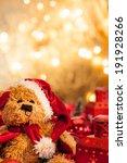 A Teddy Bear Dressed As Santa...
