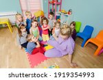 lovely preschoolers listening... | Shutterstock . vector #1919354993