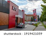 Small photo of HAVIROV, CZECH REPUBLIC - SEPTEMBER 13, 2019: Mitsubishi Lancer car in front of drive-through window at KFC restaurant waiting for fast food
