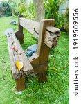 wooden bench on a green...   Shutterstock . vector #1919509556