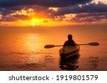 Girl Kayaking On An Inflatable...