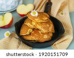 Small photo of Homemade sweet apple pancakes with grated apples and cinnamon for tea
