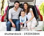 happy family sitting in the car  | Shutterstock . vector #192043844