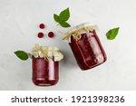 Jars Of Raspberry Jam On Light...