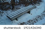 A Wooden Bench On A Mountain...