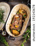 Vegetables roasted with venison and rosemary - stock photo