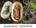 Roasted venison with herbs and vegetables - stock photo