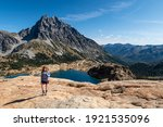 A Woman Hiker Picture with Lake Ingalls and Mt Stuart. Alpine Lakes Wilderness, Cascade Mountains, Washington