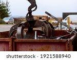 Small photo of Loading scrap metal into a truck. Crane grabber loading metal rusty scrap in the dock