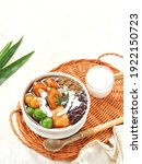 Small photo of Bubur Kampiun, is Minang special Kolak is often found during Ramadan. Combining rice pudding, green bean and black sticky rice porridge, Candil and banana compote, makes this dish even more special.