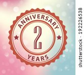 """2 Years Anniversary"" - Retro style seal, with colorful bokeh background EPS 10 vector"