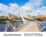 """Urban skyline of Derry city (also called Londonderry) in northern Ireland with the famous """"Peace Bridge"""" (Europe - Northern Ireland)"""