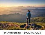 Girl On Mountain Peak With...