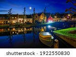 River town in evening scene. Holland evening river town. River boat evening town. Evening river town view