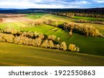 Small photo of Agriculture farm hill fields landscape. Agriculture farm field landscape. Agriculture farm field view. Agriculture farm fields landscape