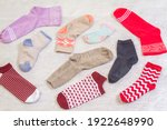 Small photo of Background with many socks. National Sock day or Odd Socks Day background design element. Bright multi-colored socks for women and children.