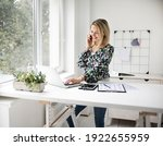 Businesswoman Telephoning Using ...
